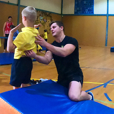 Proactivity Gymnastics Coach Helping Student